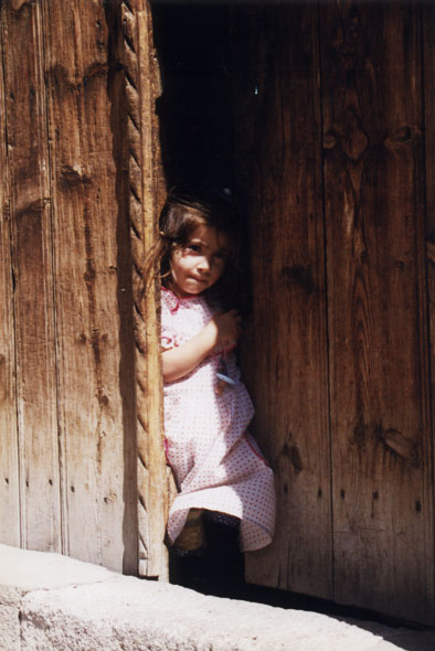shy girl in a doorway