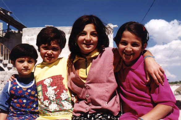 four girls smile for the camera