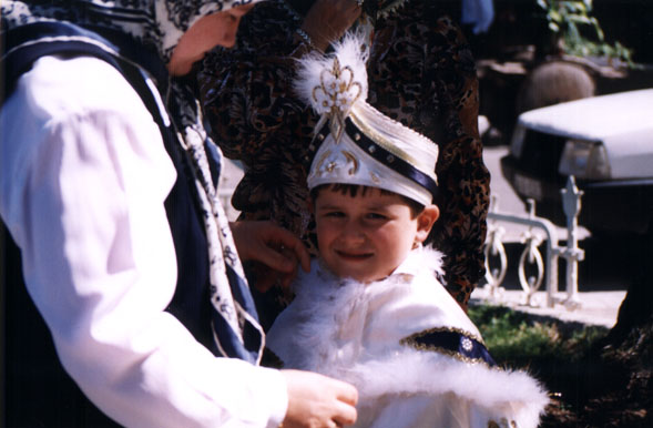 Young boy in royal circumcision costume