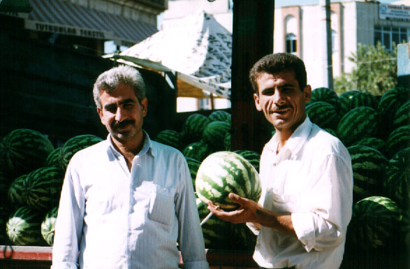 two men and their watermelons
