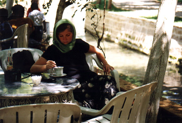 Susanne in a headscarf at a teagarden